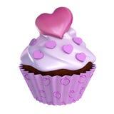 与心脏冠上的华伦泰杯形蛋糕 免版税库存照片