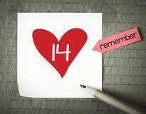 与心脏和14标志的笔记 免版税库存图片