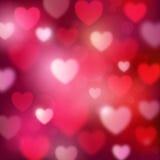 与心脏和bokeh光的抽象浪漫红色背景 免版税图库摄影