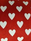 与心脏图设计的织品,织地不很细背景 免版税库存图片