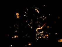 与心脏形状的闪耀的火 免版税库存照片