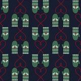 与心脏的冬天手套无缝的样式为xmas假日 图库摄影