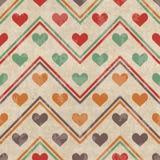 与心脏的几何无缝的样式 免版税库存照片