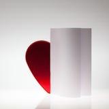与心脏的对称抽象纸背景 免版税库存照片
