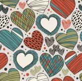 与心脏的无缝的华丽样式 不尽的手拉的逗人喜爱的背景 库存照片