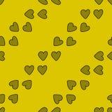 与心脏的无缝的样式在黄色背景 库存照片