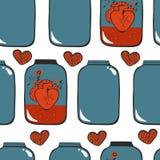 与心脏的样式在瓶子 免版税库存图片
