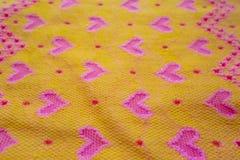 与心脏的黄色织品 图库摄影