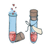 与心脏象在手中被画的样式的两个管测试 爱不老长寿药 免版税库存图片