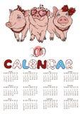 与快乐的桃红色猪公司的日历  库存照片