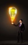 与想法电灯泡的商人 免版税库存照片