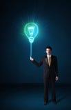 与想法电灯泡的商人 图库摄影