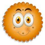 与愉快的面孔的曲奇饼 免版税库存照片