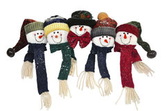 与愉快的面孔的雪人家庭 库存图片
