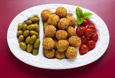 与意大利煨饭球arancini,绿色ol的健康意大利开胃菜 免版税库存照片