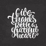 给与感恩的心脏-感恩天字法书法词组的感谢 秋天在隔绝的贺卡 免版税库存照片