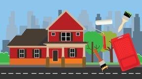 与房子和颜色工具的家庭油漆绘画 库存照片