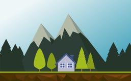 与房子的山风景 免版税库存照片