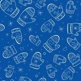 与手套的冬天无缝的样式在蓝色backg 免版税库存照片