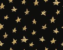 与手拉的星的纹理 与金子的无缝的样式在黑背景担任主角 免版税库存图片
