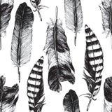 与手拉的羽毛的无缝的样式 免版税库存图片