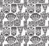 与手拉的花梢面具的无缝的样式在非洲s 库存照片