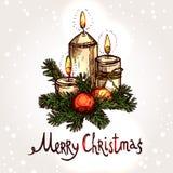 与手拉的蜡烛的圣诞卡 免版税库存照片