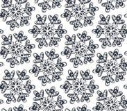与手拉的雪花的无缝的样式 免版税图库摄影