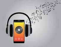 与手机智能手机和耳机歌曲曲调的听的音乐 库存图片