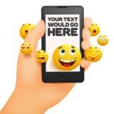 与手机的Emoji愉快的兴高采烈的设计在手中 免版税库存照片