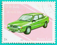 与打印的邮票在老挝显示汽车 免版税库存图片