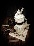 与打好的奶油的咖啡鸡尾酒在一个浓咖啡杯子 奇怪照片编辑 库存照片