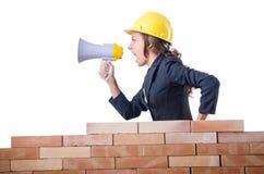 与扩音器的妇女建造者 免版税库存图片