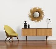 与扶手椅子和镜子的斯堪的纳维亚嵌墙桌子 免版税图库摄影
