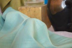 与折叠的薄菏色纺织品 免版税库存照片