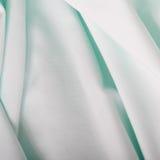 与折叠的绿松石织品 库存照片