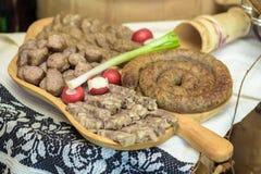 与护痉套,香肠,专业猪肉的开胃菜 图库摄影