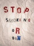 与抽烟文本的中止的赎金票据或死 图库摄影