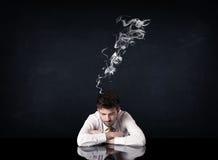 与抽烟的头的沮丧的商人 免版税图库摄影