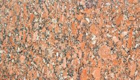 与抽象自然啪答声的美丽的高详细的红色花岗岩 免版税图库摄影