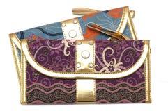 与拉链制帽工人的紫色和蓝色囊 免版税库存图片