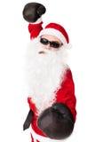 与拳击手套的圣诞老人佩带的太阳镜 库存图片