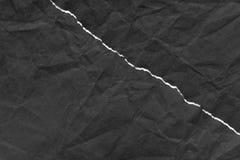 与拷贝空间背景纹理的黑被撕毁的纸 免版税库存照片
