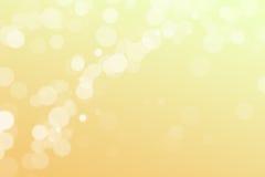 与拷贝空间的淡色黄色阳光bokeh背景 库存照片