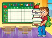与拿着书的男孩的学校时间表 免版税库存图片
