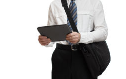 与拿着公文包和片剂个人计算机的领带的商人 图库摄影