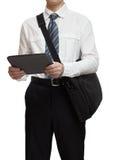 与拿着公文包和片剂个人计算机的领带的商人 免版税图库摄影