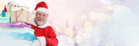 与拿着礼物的冬天风景的圣诞老人 库存图片