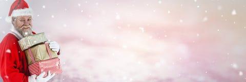 与拿着礼物的冬天风景的圣诞老人 免版税库存照片