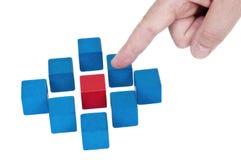 与指向手指的被隔绝的积木 免版税库存照片